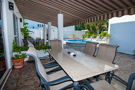 Poolside patio at Casa Jen Cozumel vacation rental property