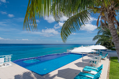View of the swimming pool at Miramar vacation rental condos on the island of Cozumel Mexico from the second level