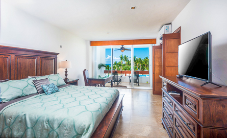 View of dining room and kitchen at  Residencias Reef 5220 2 BR Cozumel Vacation Rental Condo