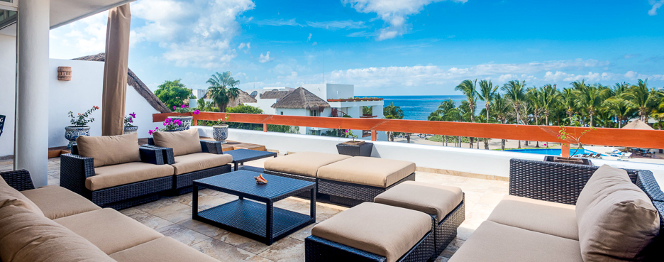 Sliding glass doors open to the patio of Residencias Reef 5220 2 BR Cozumel Vacation Rental Condo