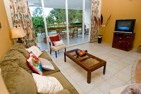 Sliding glass doors to the patio area  from the living room in RR 7160 at Residencias Reef vacation rental condo