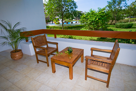 Step off the RR 7160 patio at  Residencias Reef to the garden area and pool