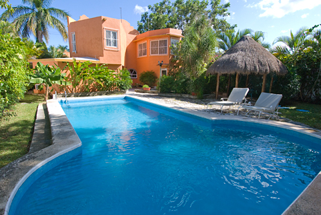 Pool view of Hacienda Sombrero 4 BR vacation rental villa in Cozumel