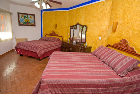 Wide screen TV in living area of Hacienda Sombrero 4 BR vacation rental villa in Cozumel